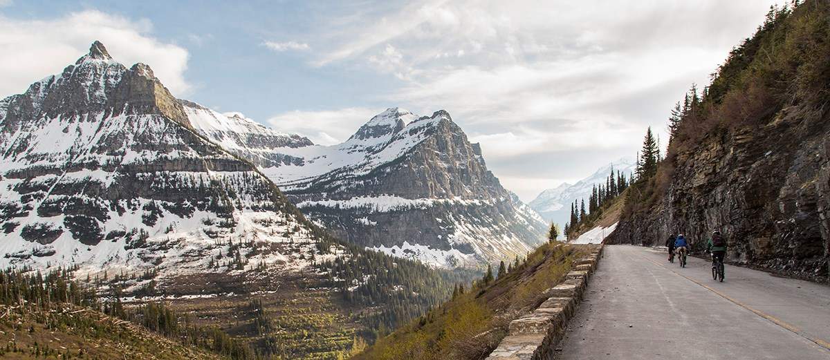 Bikers cycle past the iconic Weeping Wall in Glacier National Park.  Source: National Park Serivce