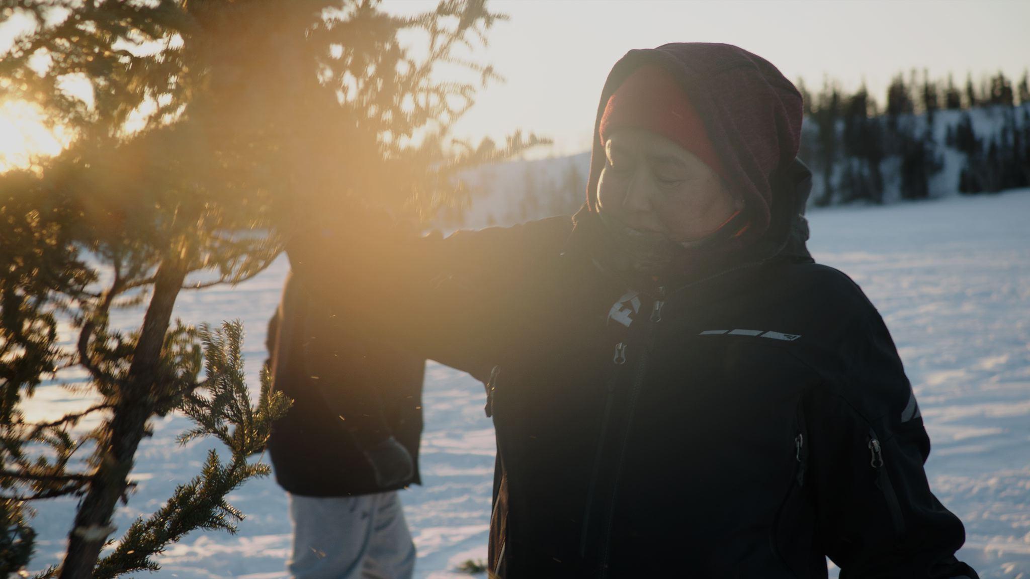 Elders in Wollaston Lake, Saskatchewan teach kids to light a signal fire.
