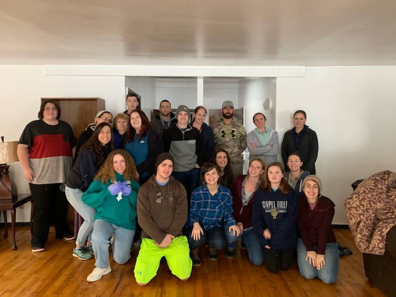 Trinity Youth joined rubber gloves with other local volunteers to lend a hand at Faith House.