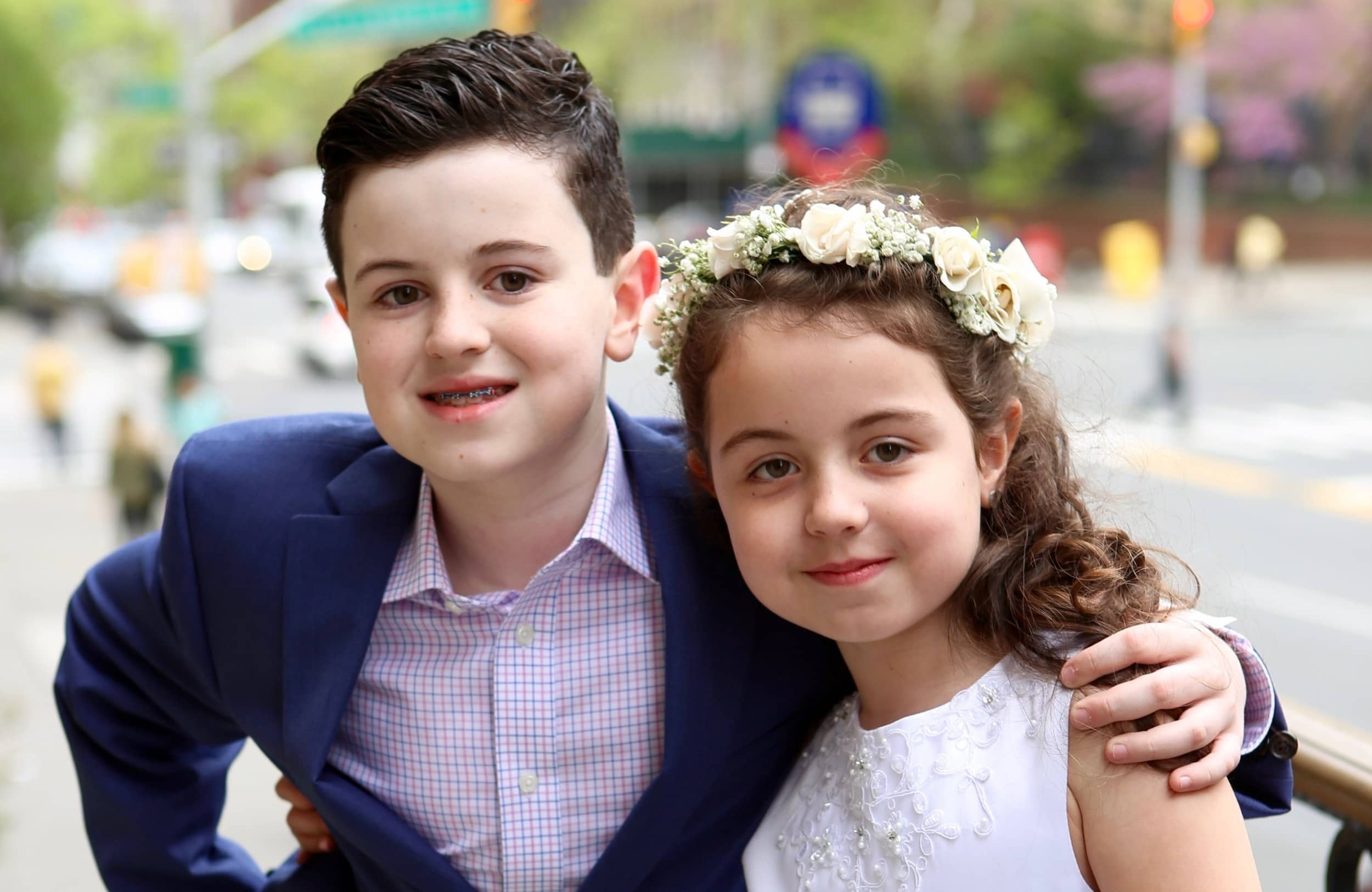 first-communion-kids-arms-around-st-francis-de-sales-church-new-york-city.jpg