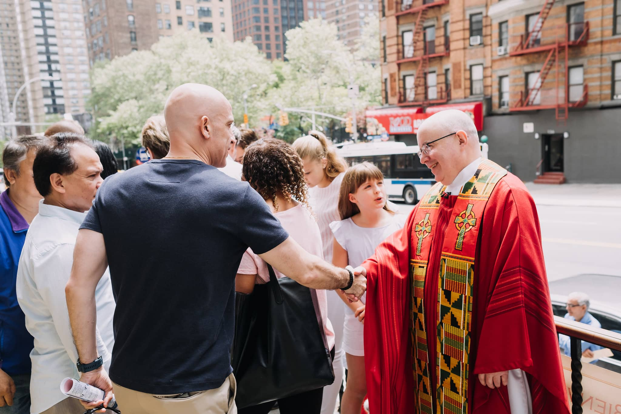 handshake-greeting-outside-mass-st-francis-de-sales-church-new-york-city.jpg