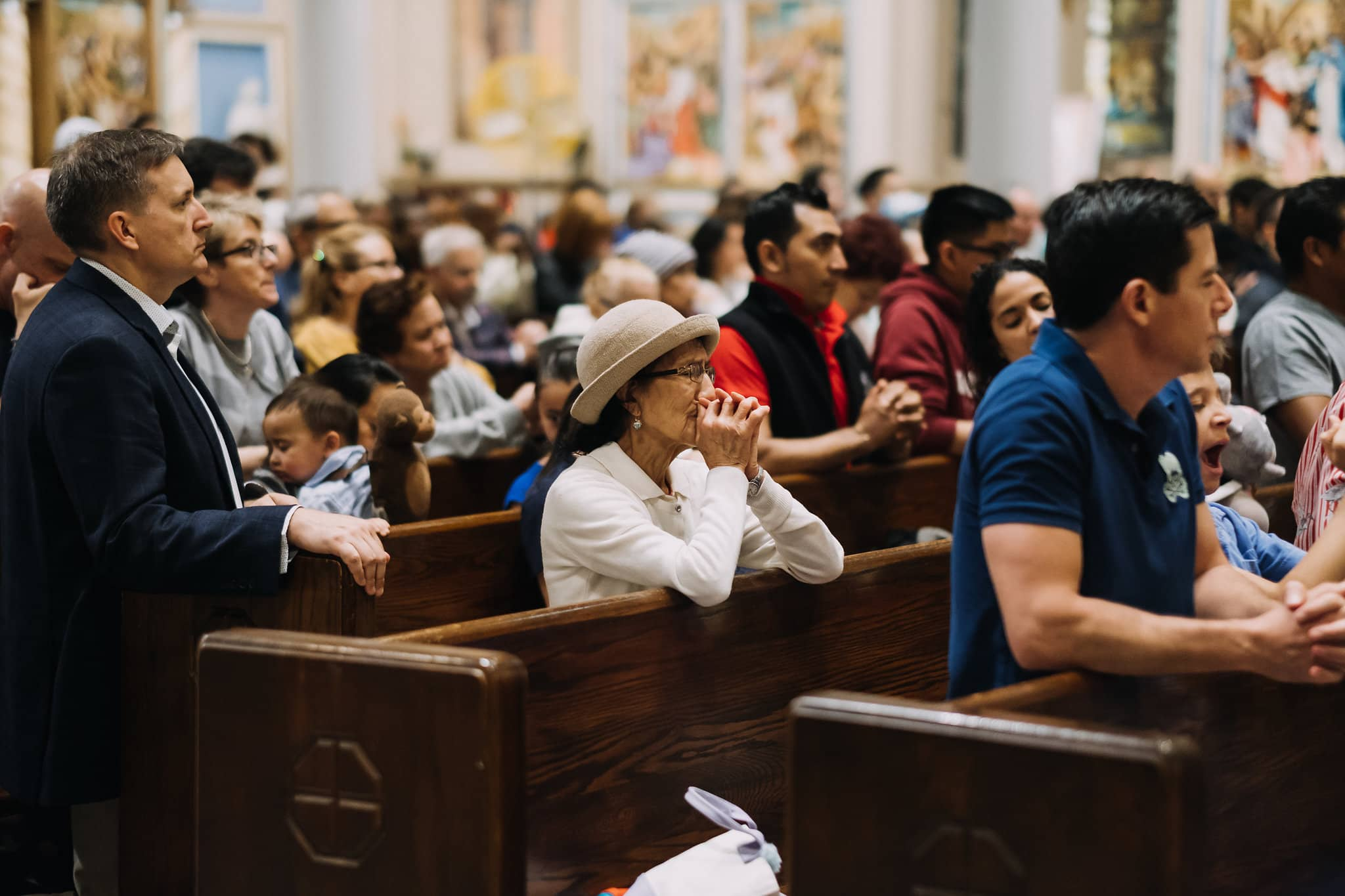 prayer-together-senior-elderly-diverse-mass-st-francis-de-sales-church-new-york-city.jpg