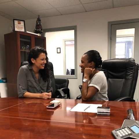 Cynthia and Andria excitedly discussing Ali Forney Center's mission