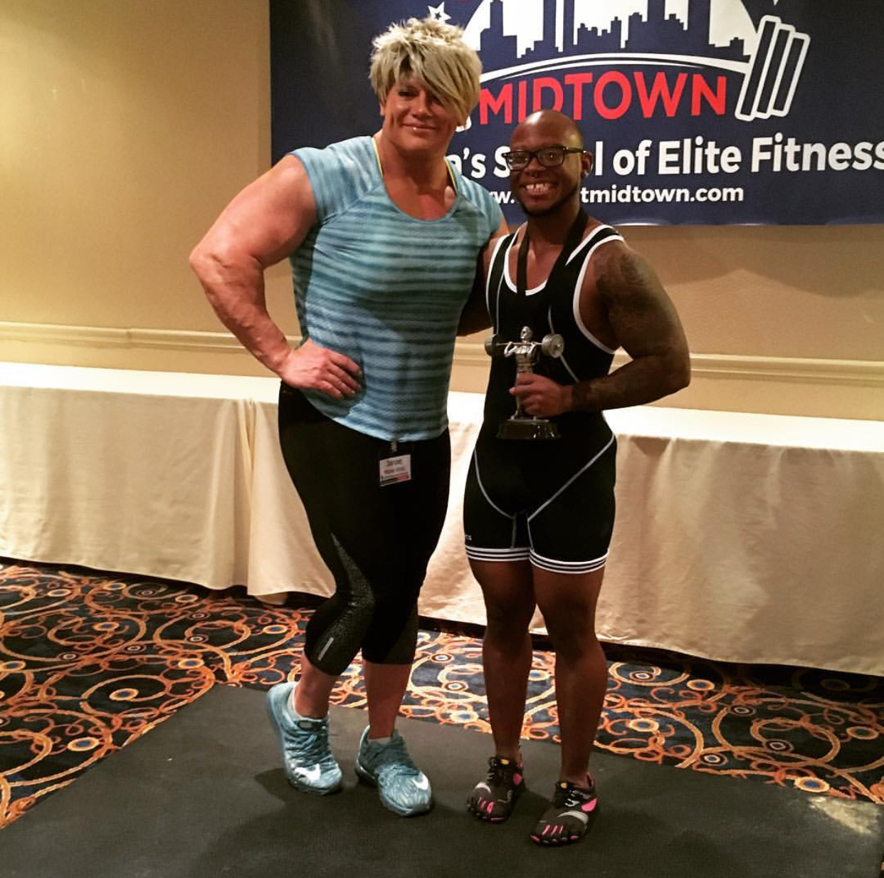 - Zami posing with the amazing Janae Marie, after winning first place at the first Powerlifting Competition hosted at the FTM FitCon in Atlanta, GA.