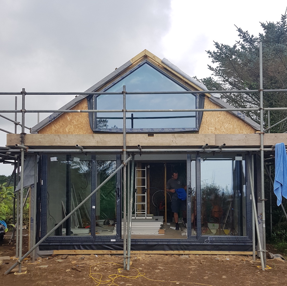 The day the windows went in was a good day. The original plan to have a wall of windows was going to be too expensive, so Hugh designed the upper window to help keep within budget while letting maximum light in. The sliding doors are UPVC in Anthracite grey. The studio is south facing so will have low heating costs due to roof, wall and floor insulation and plenty of sunshine. {Well, some. This is Cornwall, not the south of France.}