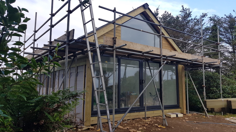 The studio is clad in tanalised wood. It starts off with a green tinge, turns gold, and ends up with a silvery look, not unlike cedar cladding but more affordable. My bedroom is clad the same way and at time of writing is in the gold phase - beautiful.