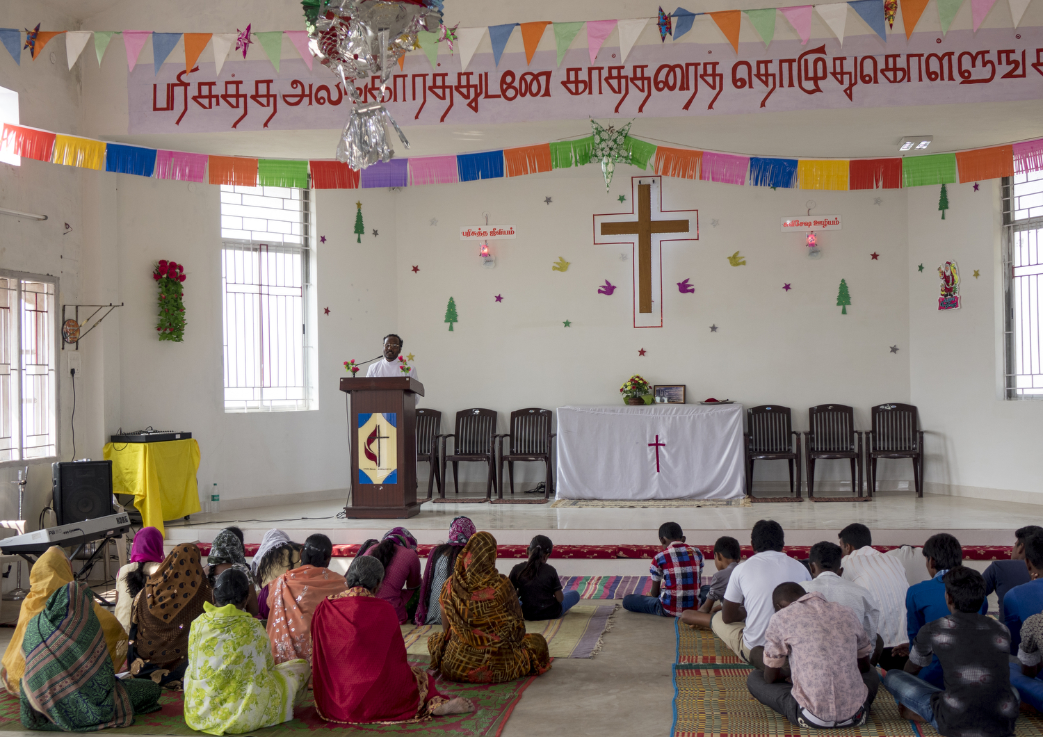 Charles Finny. T - The Christian people of Kalaignar Nagar worship God in church on Sunday morning. They are respecting their God as they come together for prayer in the only church in the settlement.