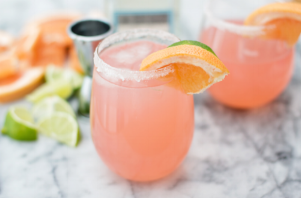 Amanda's Paloma Recipe - Tequila, Topo Chico mineral water and a splash of ruby red grapefruit juice. Garnish with serrano pepers slices.