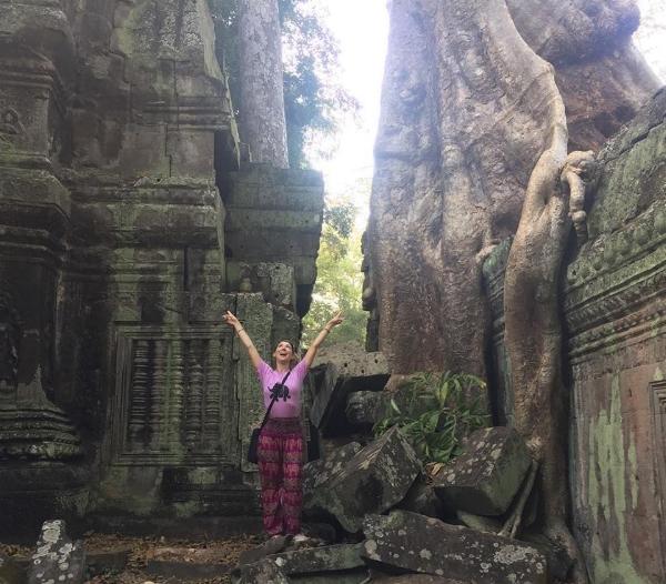 Embracing her inner Lara Croft in Ta Prohm, Cambodia.