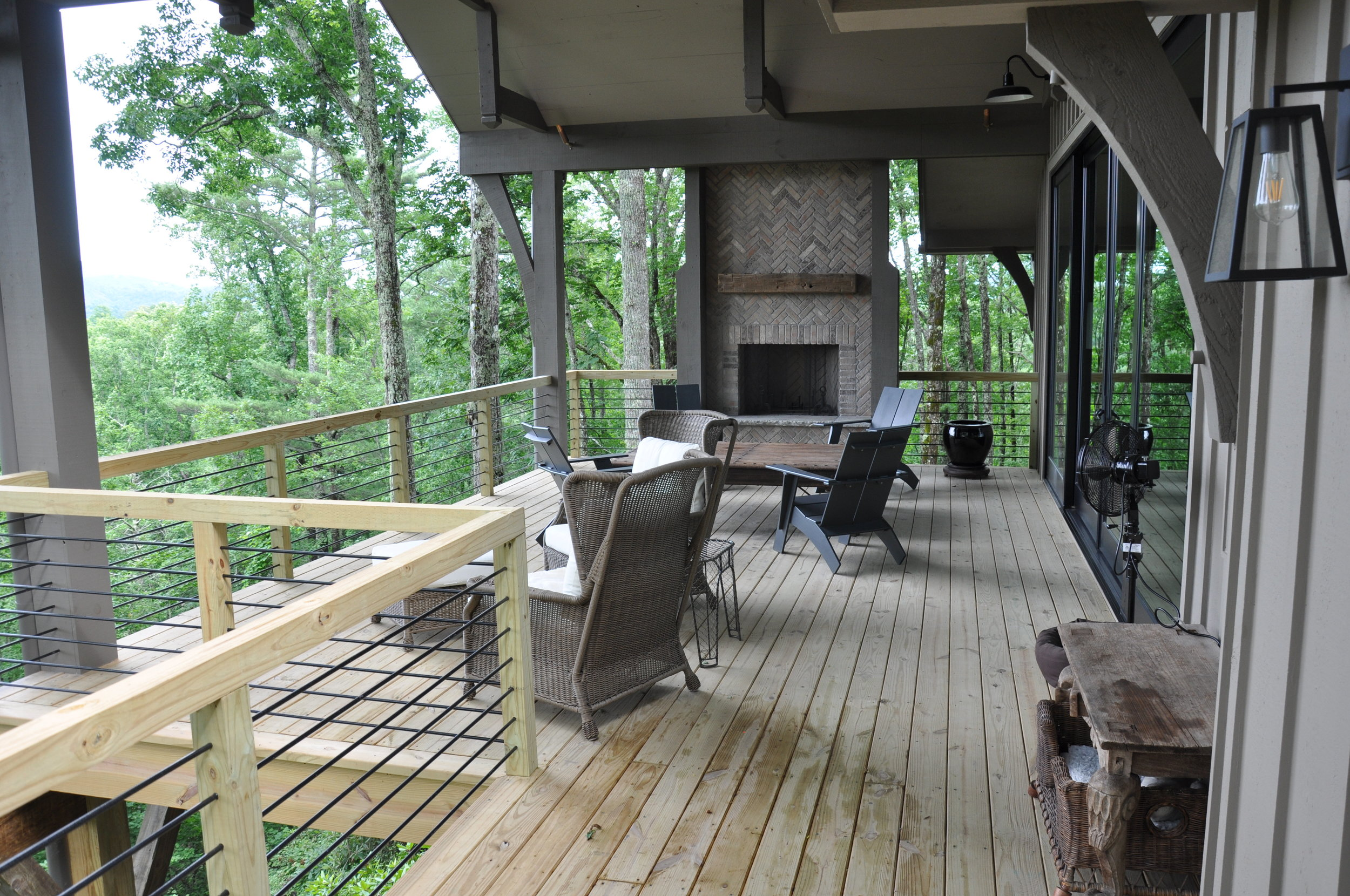 a new covered porch with fireplace replaced a rarely used open deck.