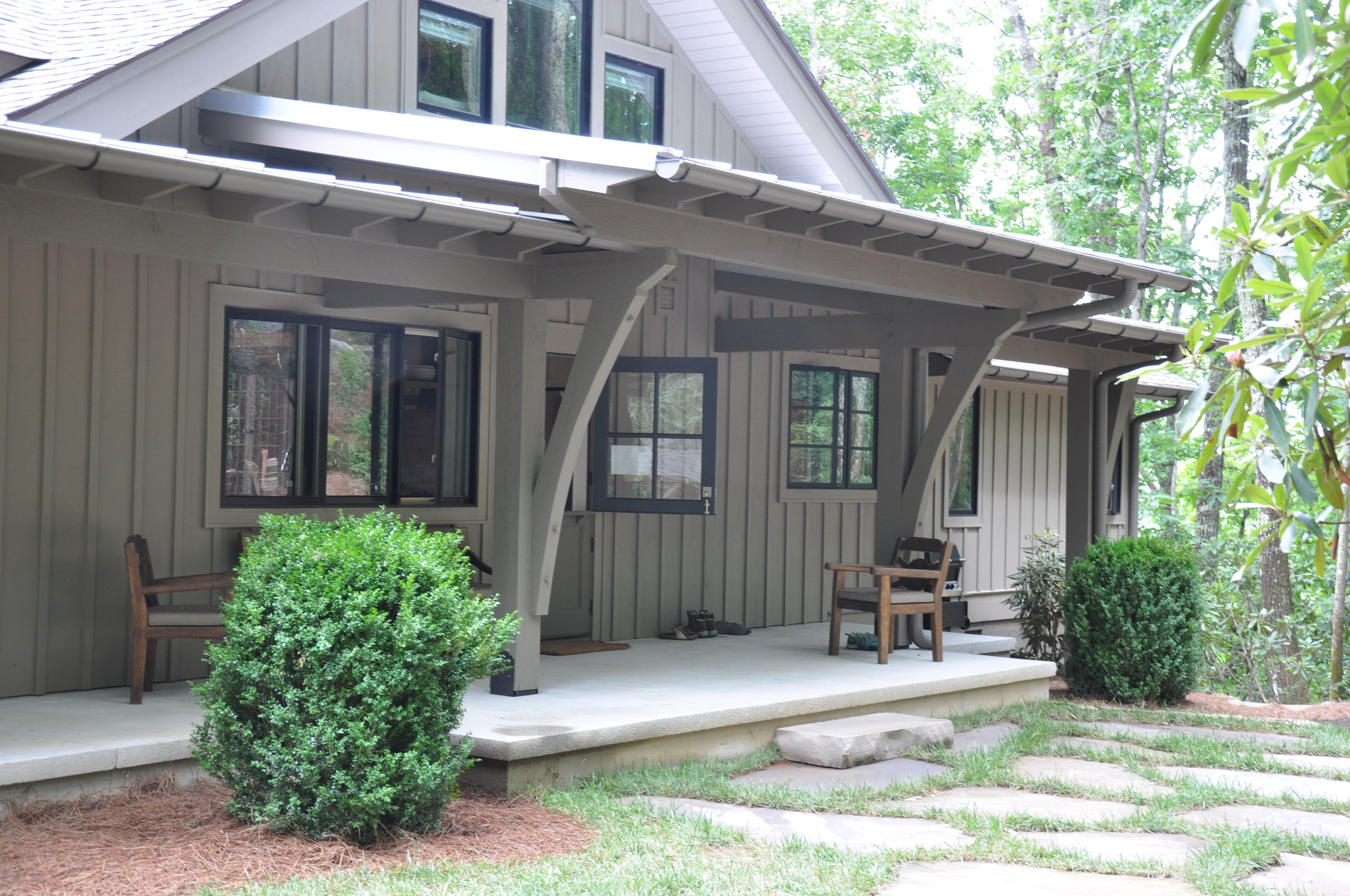 new covered front porch is one of owner's favorite spaces.