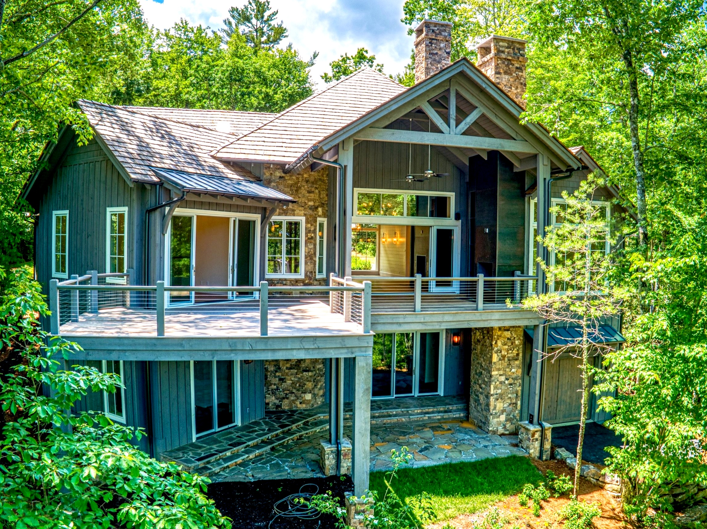 Nestled in the forest, deck extends out to capture more golf course views.