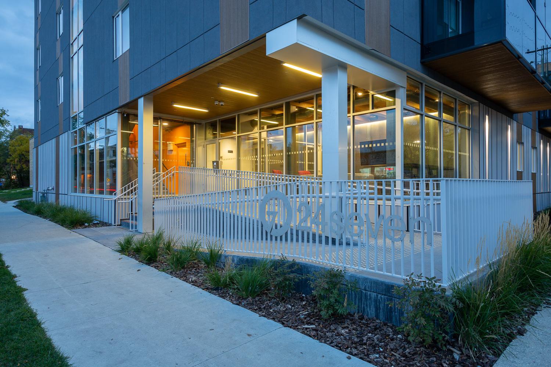 24Seven Condominiums, exterior photo of the building entrance at dusk / Photo:  Lindsay Reid