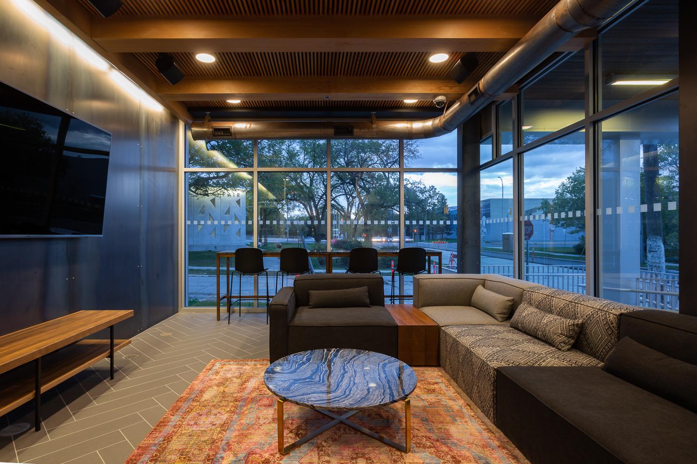 24Seven Condominiums, interior photo of the main common room at dusk / Photo:  Lindsay Reid
