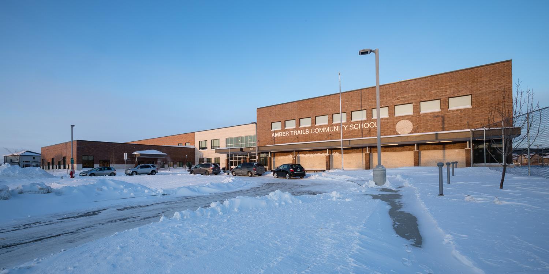 Amber Trails Community School, exterior photo of school at sunset / Photo:  Lindsay Reid