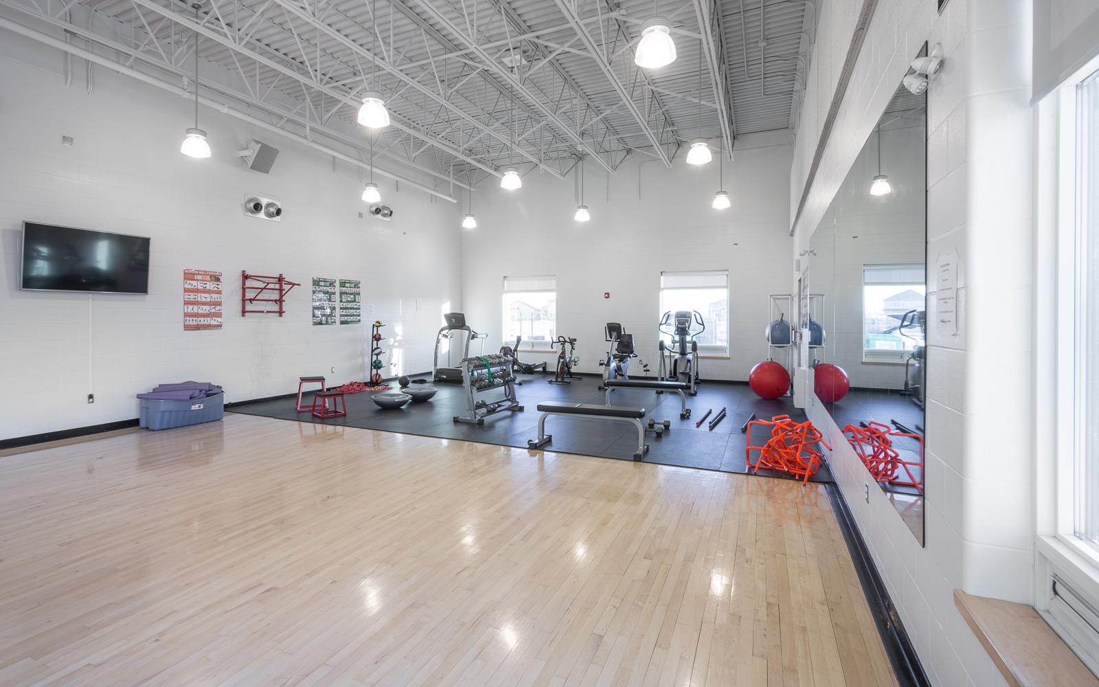Amber Trails Community School, interior photo of gym workout room / Photo:  Lindsay Reid