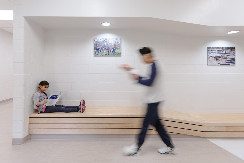 Amber Trails Community School, interior photo of hallway bench detail with children / Photo:  Lindsay Reid