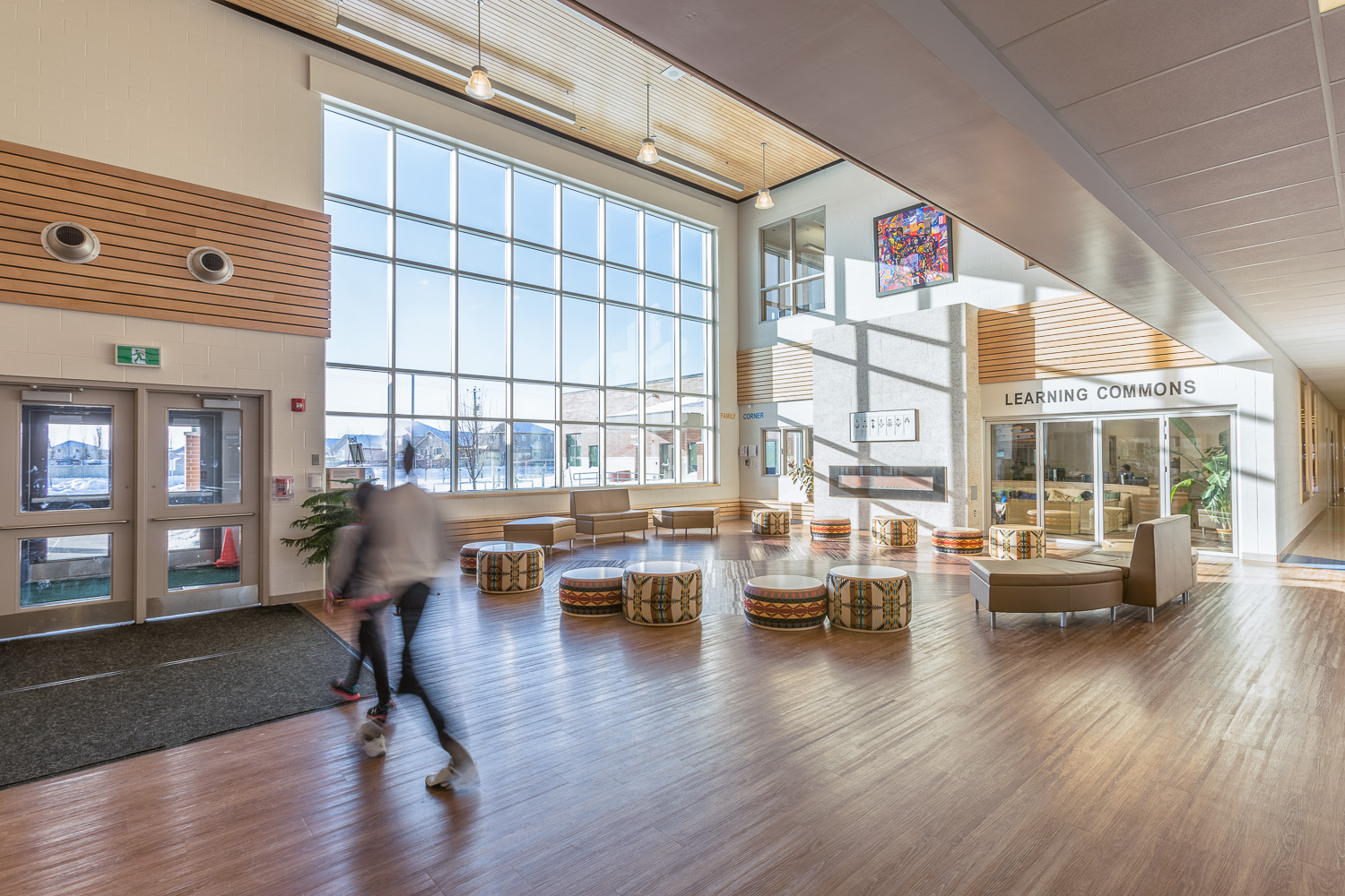 Amber Trails Community School, interior photo of main lobby with children walking / Photo:  Lindsay Reid