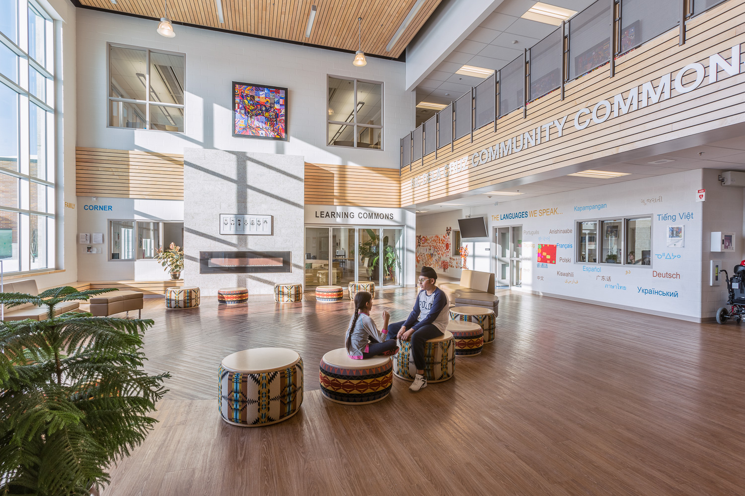 Amber Trails Community School, interior photo of main lobby with children sitting / Photo:  Lindsay Reid