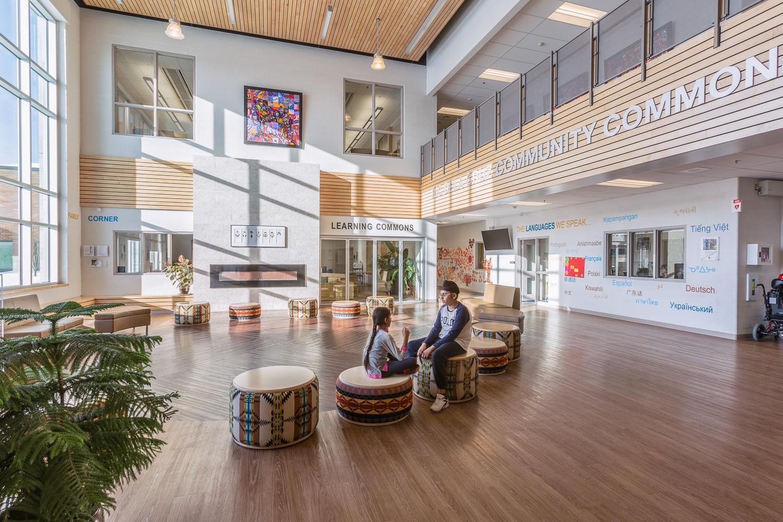 Amber Trails Community School, interior photo of main lobby with children sitting / Photo:  Lindsay Reid