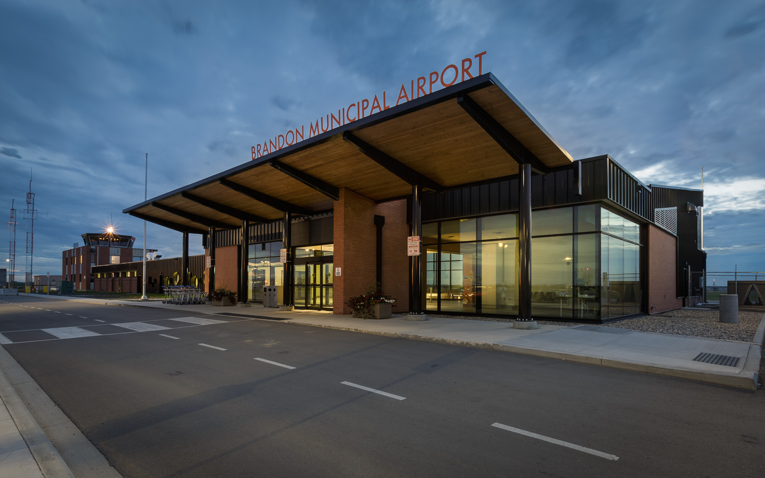 Brandon Municipal Airport, exterior photo of building at dusk / Photo:  Lindsay Reid