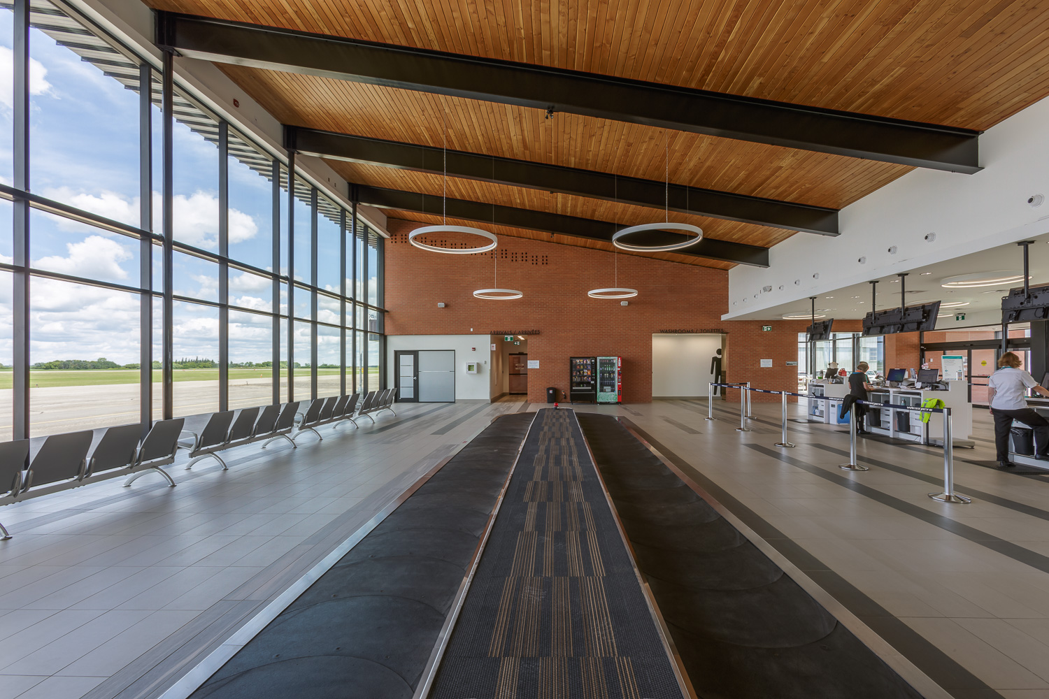Brandon Municipal Airport, interior photo of empty Arrivals Hall and baggage carousel / Photo:  Lindsay Reid