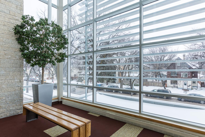 Centre de Santé Marcel A. Desautels, interior photo of bench and window detail / Photo:  Lindsay Reid