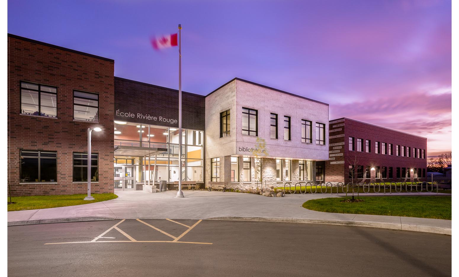 Ecole Rivière Rouge Elementary, exterior photo of school at sunrise / Photo:  Lindsay Reid