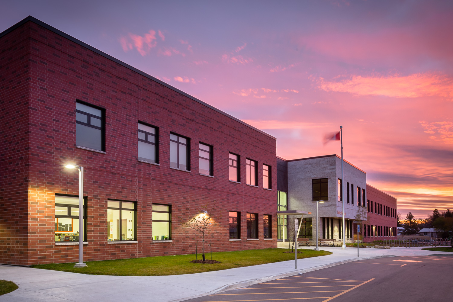 Ecole Rivière Rouge Elementary, exterior photo of building at sunrise / Photo:  Lindsay Reid