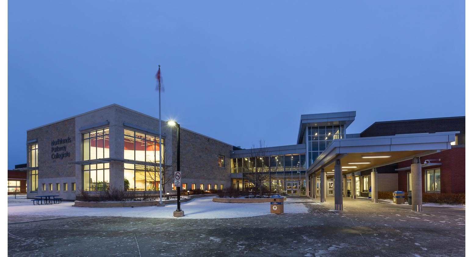 Northlands Parkway Collegiate, exterior photo of building at dusk / Photo:  Lindsay Reid