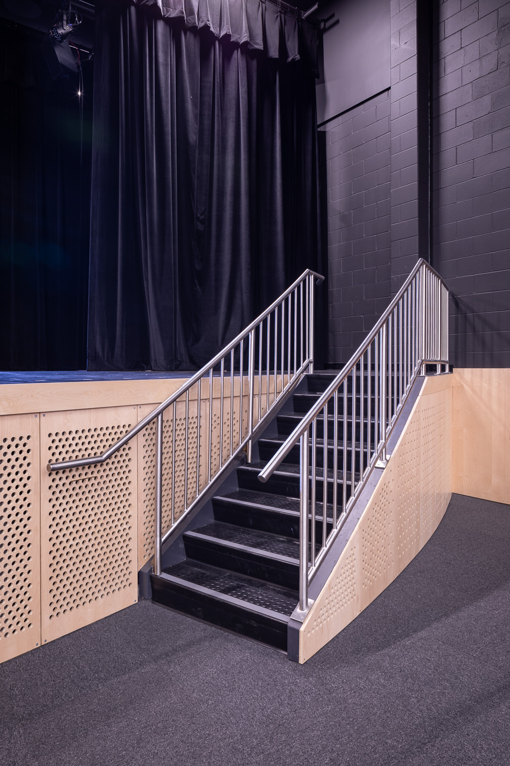 Seven Oaks Performing Arts Centre, interior detail photo of the theatre stairs to stage / Photo:  Lindsay Reid