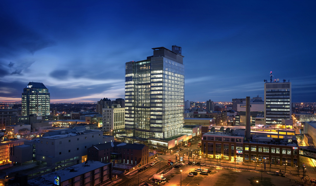 Manitoba Hydro Place, exterior photo of building at dusk / Photo: Gerry Kopelow