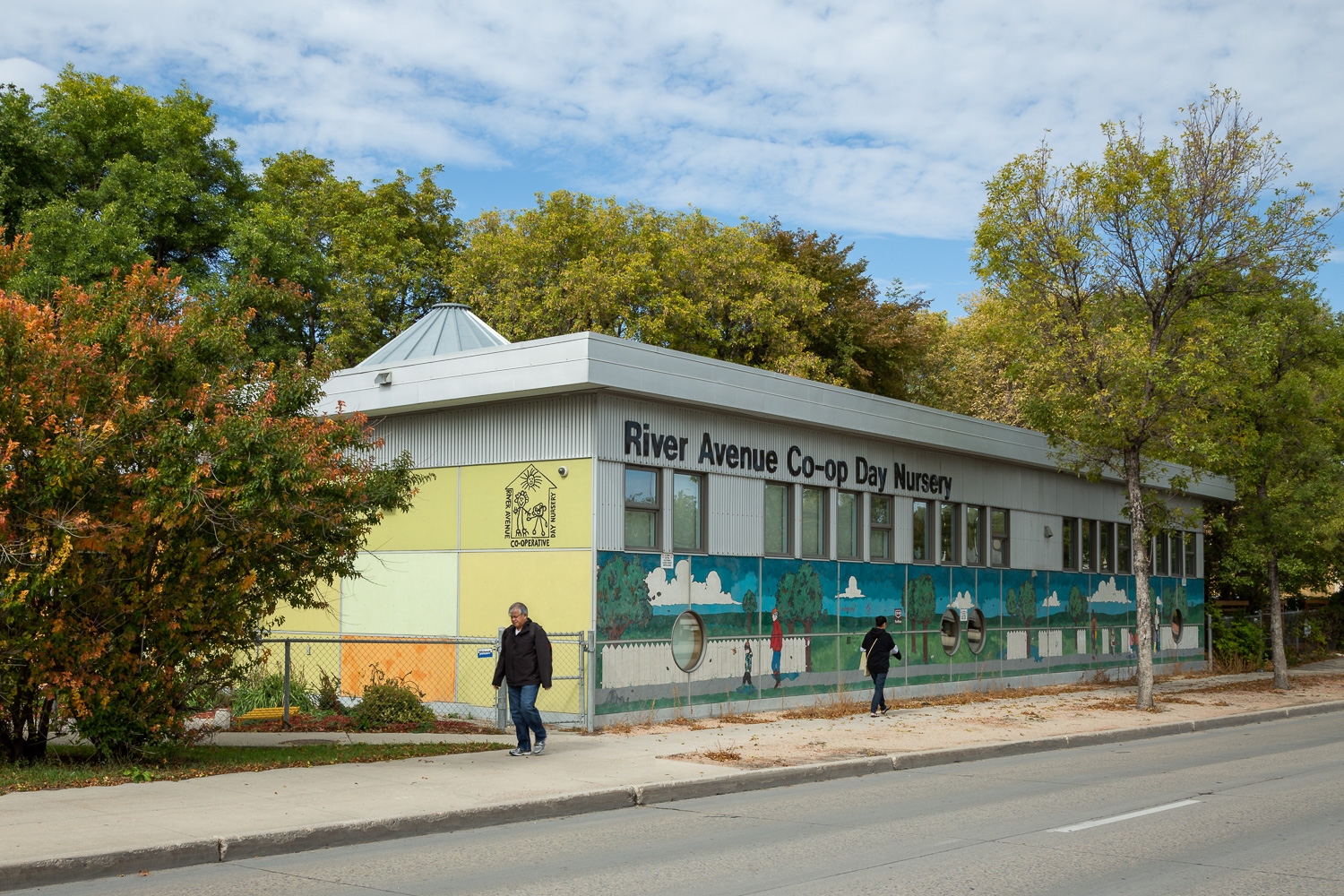 River Avenue Daycare, exterior photo of building with people walking by / Photo:  Lindsay Reid