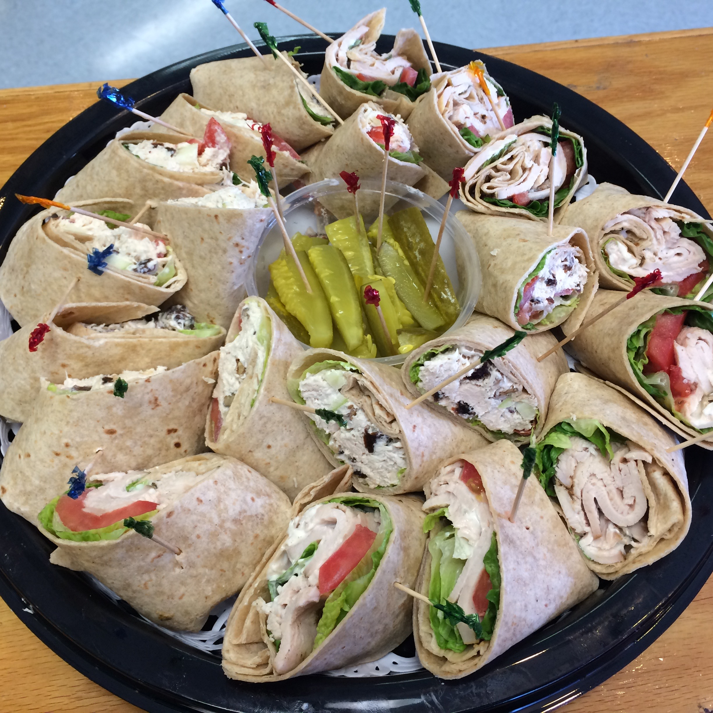Sandwich Tray - Your choice of bagels, honey wheat wraps, croissant or a mixture of all, harmonized with our hand carved, herb crusted turkey breast, Waldorf chicken salad, white albacore tuna, or our famous egg salad. All served with lettuce, tomato, onion, and pickles.$45.95