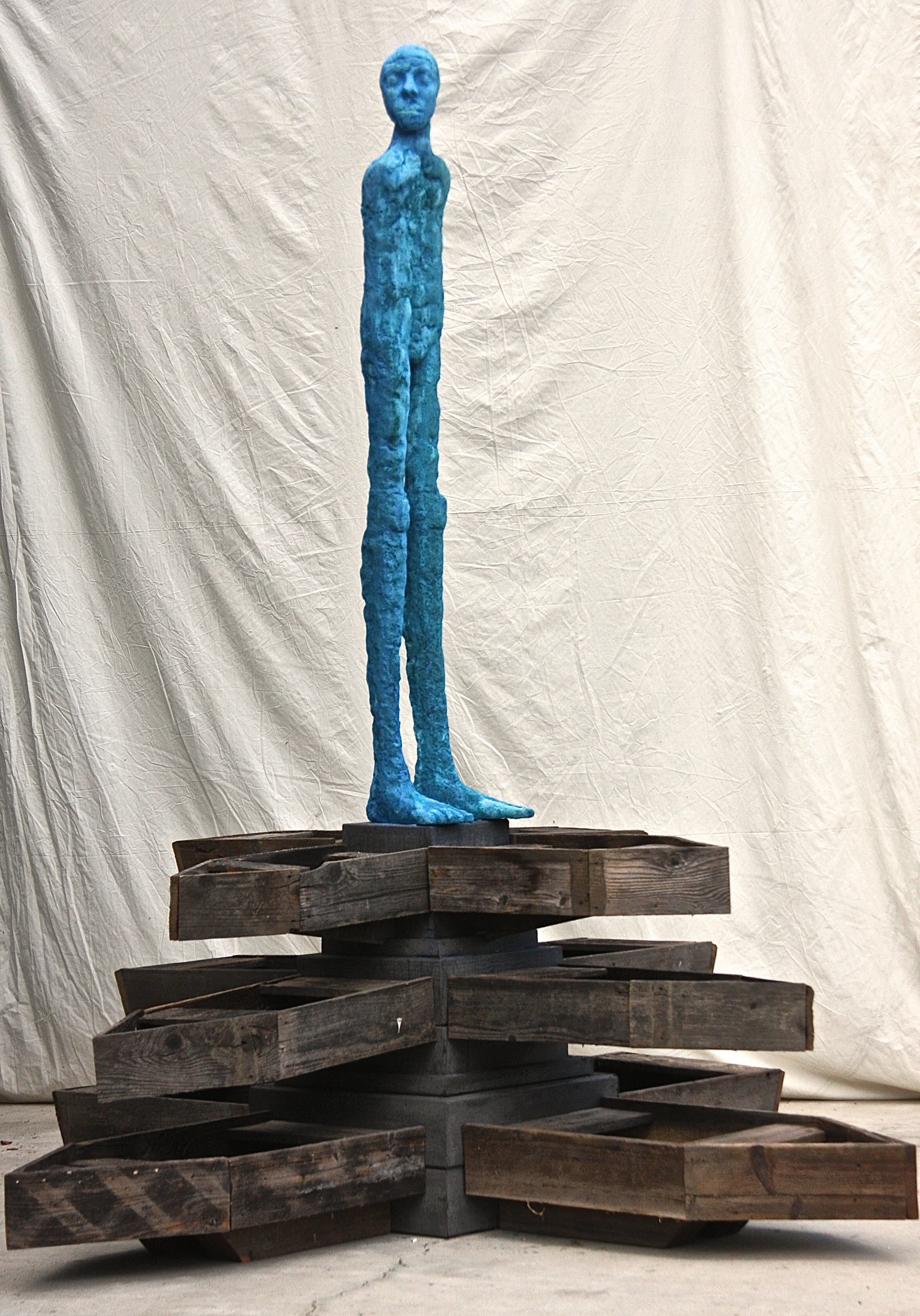 Looking east into the rising   2015-2016  Bronze and wood  98 x 76 x 76