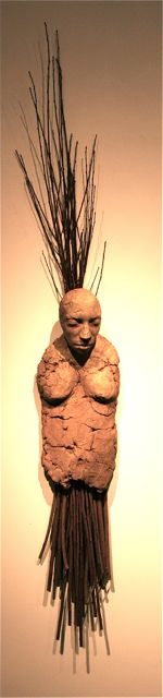 She carries her grief like orchard memories   2009  66 x 8 x 7  Ceramic and branches