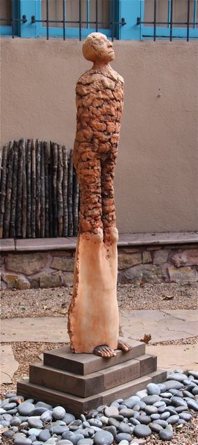 Rooted in an ever ascending spiral   2003  Ceramic and wood  69 x 16 x 26   Locked into the strengths of the earth and family, we ascend into an ever increasing view of the grandeur of the fullness of living.