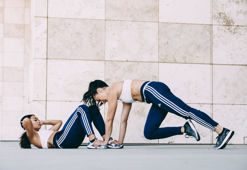 Partner 1-  25 Sit Ups. Two feet on the ground. Arms crossed or behind your head.