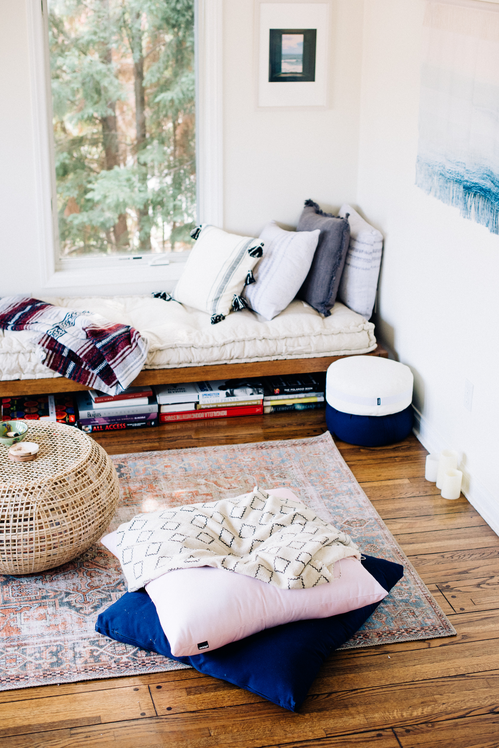 Hopper Daybed, Rohini Daybed Cushion, Marte Ottoman, Hannah Printed Rug, Ivy Fringe Striped Throw Pillow: Urban Outfitters Home  White and Grey Meditation Cushion: Walden  Wall art, macramé and pink floor cushion: Society 6