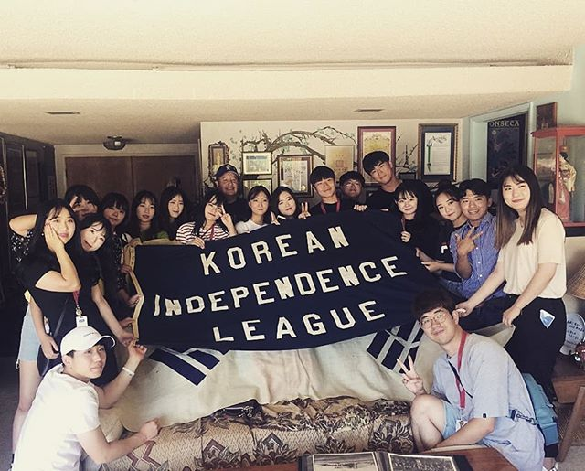 """Extremely fashionable, """"V"""" signs in the air, perfect posing? MUST BE KOREANS IN THE BUILDING!  Namseoul University students came to visit today. Coming to Flip's house is incredible because he has literally thousands of primary sources for all of your Dosan needs. And look, the 100 year old flag made another appearance 🇰🇷🇰🇷🇰🇷 If you havent learned about Dosan and his teachings, tune in to our podcast. They were truly ahead of their time. #dosan #dosanahnchangho #korea #koreanflag #koreanindependence #도산 #도산안창호 #남서울대 #flipblendsinwiththe20yearolds"""