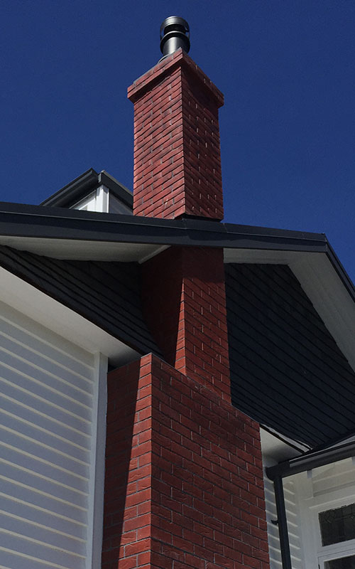 Ground to roof, red brick effect fibreglass chimney