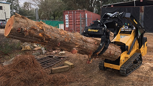 "Super Cool Mini Tractor we call the ""Dingo"" but is actually a mini skid loader with a branch manager attachment that will carry a nice sized log as well. This little tractor is only 35"" wide so it can fit through very narrow access areas to perform tree work in Tallahassee."