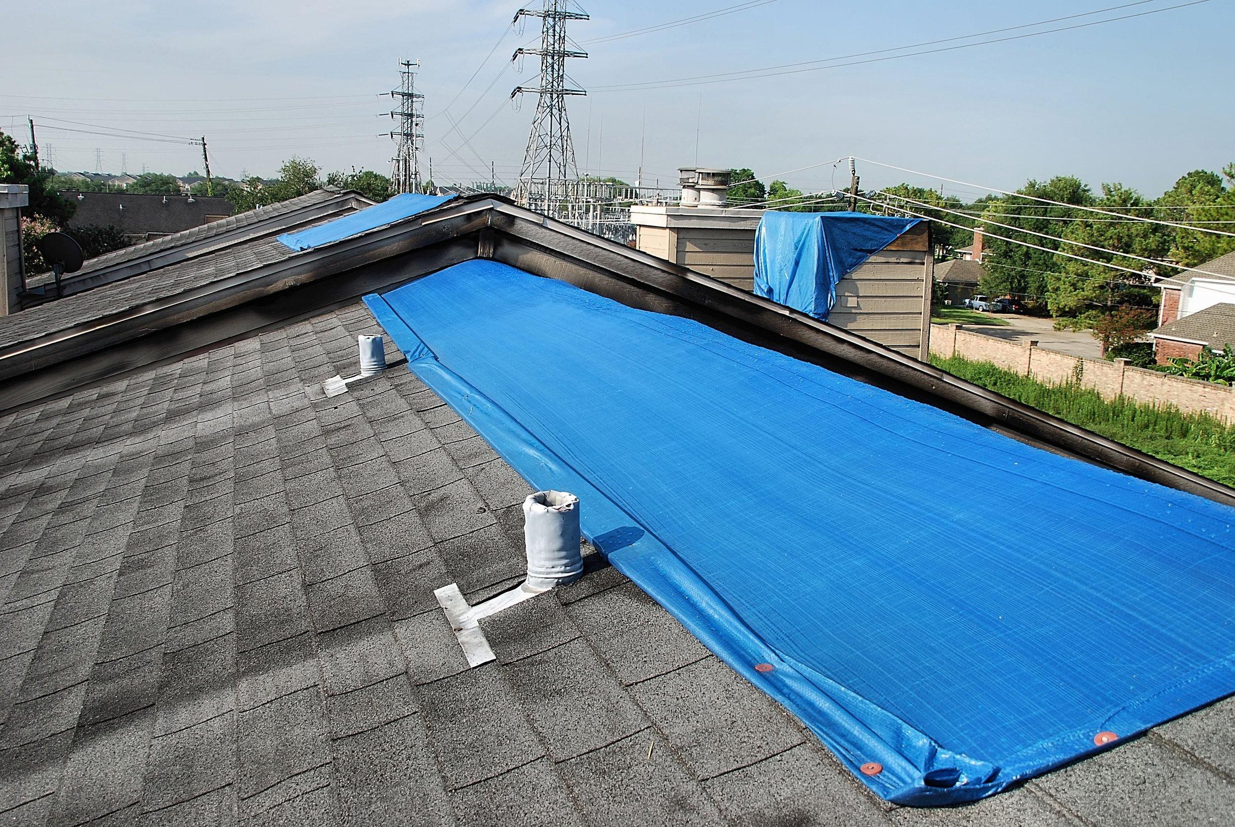 blue tarp on roof.jpg