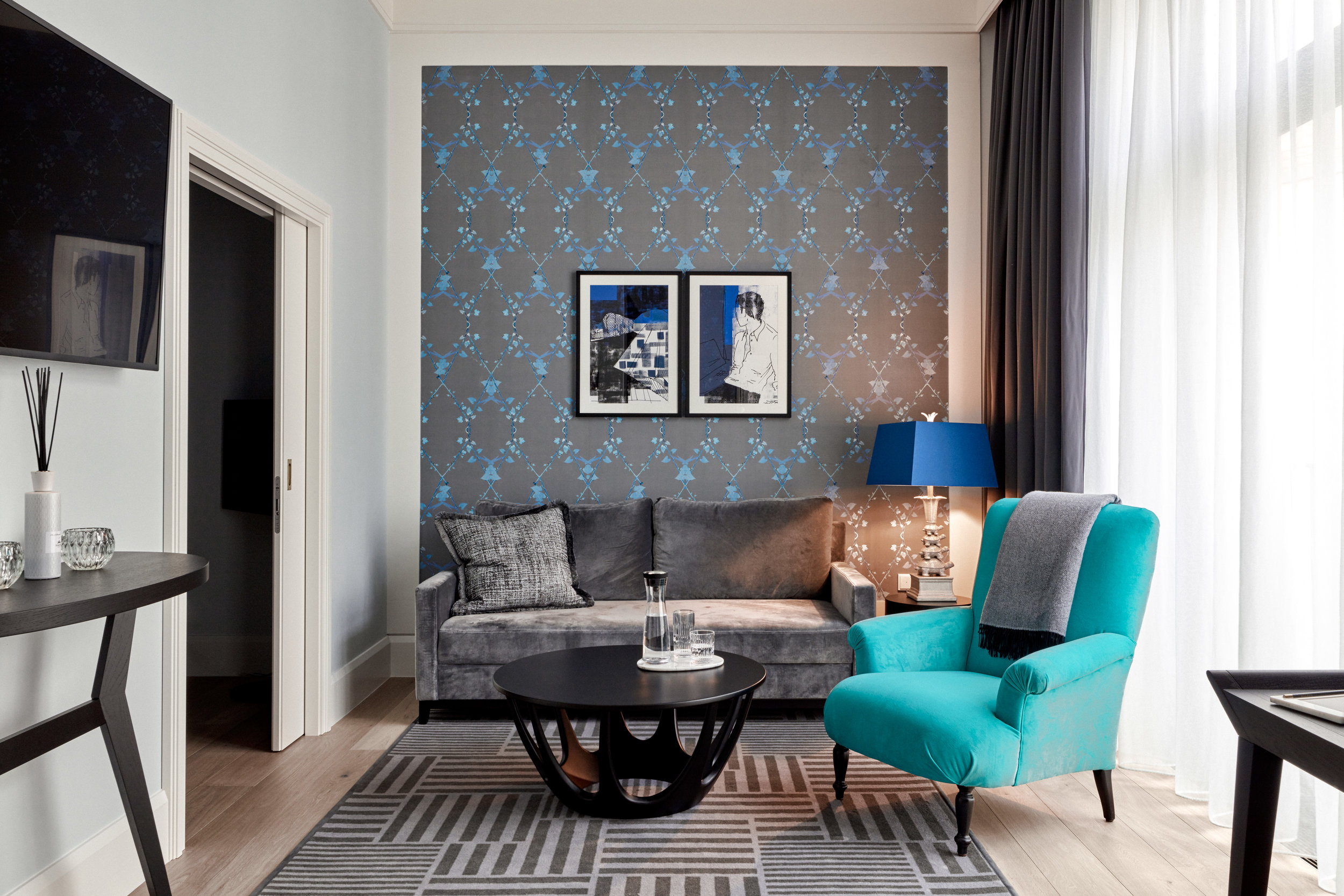 Deluxe room with Morning Glory wallpaper in custom Turquoise