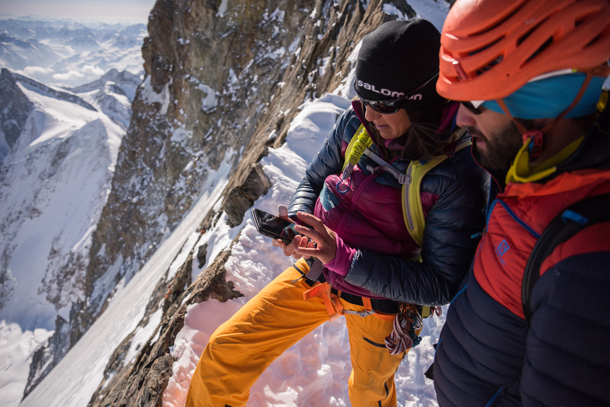 Liv Sansoz and Tony Lamiche checking FATMAP on the Finsteraarhorn