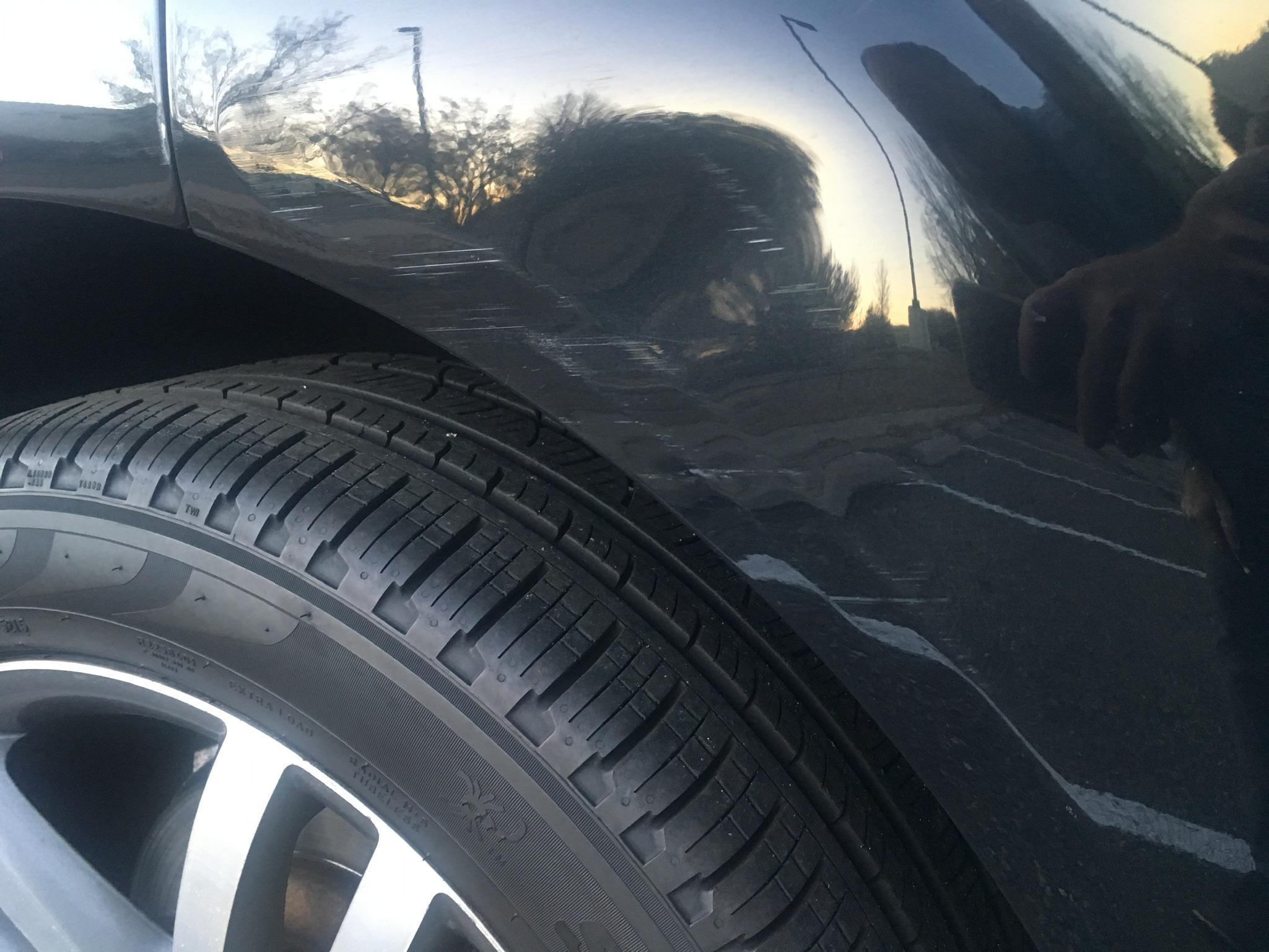 right rear fender - scrapes & minor dent