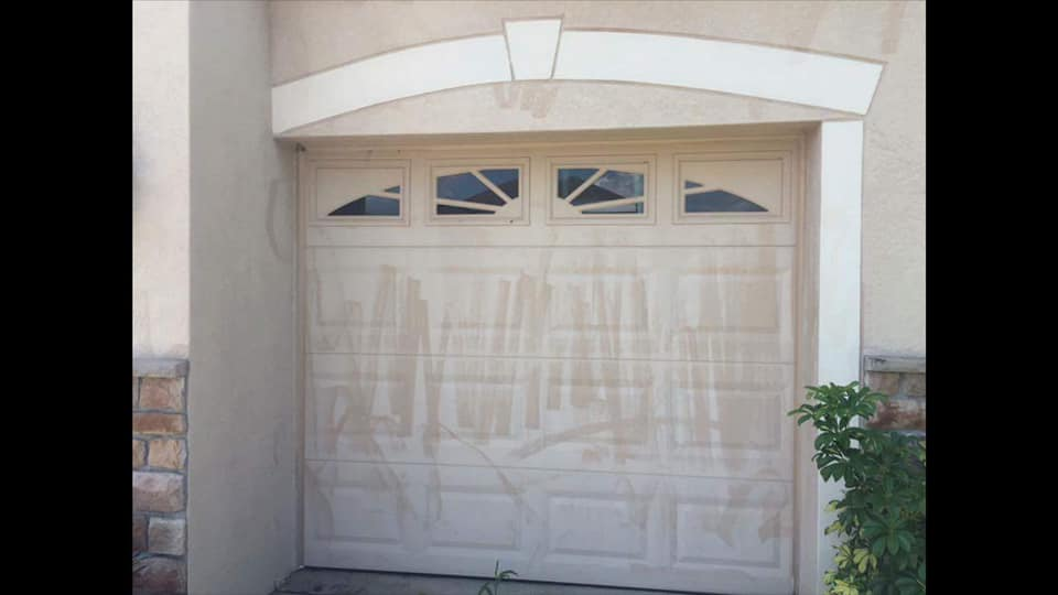 Garage Door - This is my last one. Honestly, would any homeowner want their garage door to look like this? I hope not.