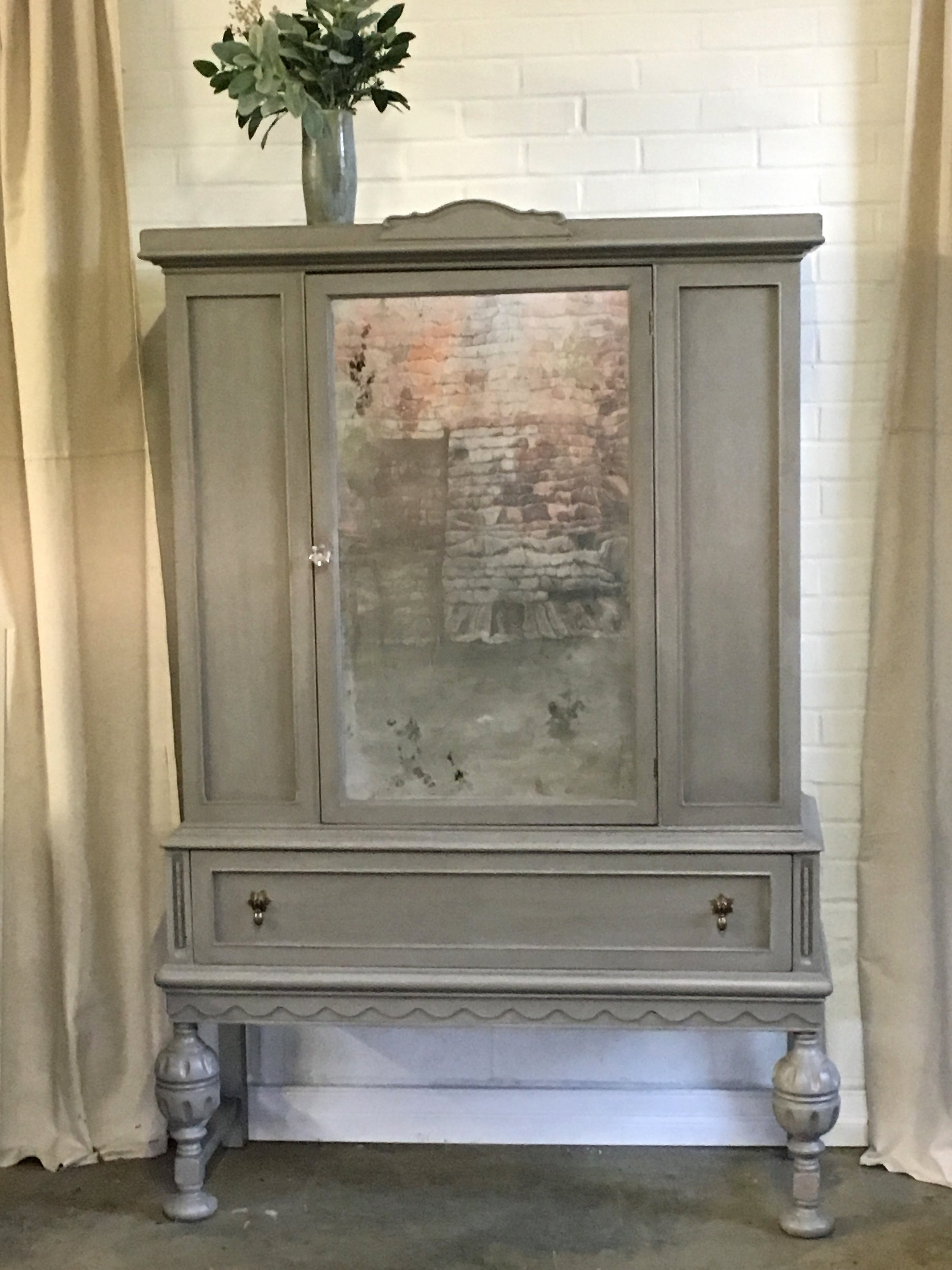 Beautiful cabinet for any room. Grey with slight distressing and antique mirror.