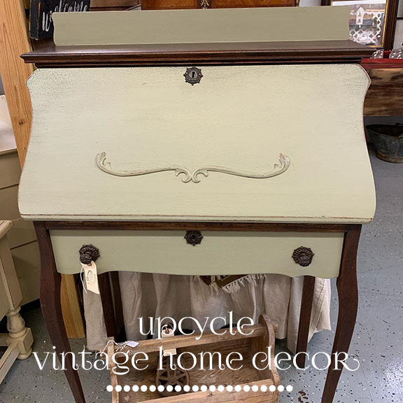 Distressed paint and stain refreshed this petite writing desk