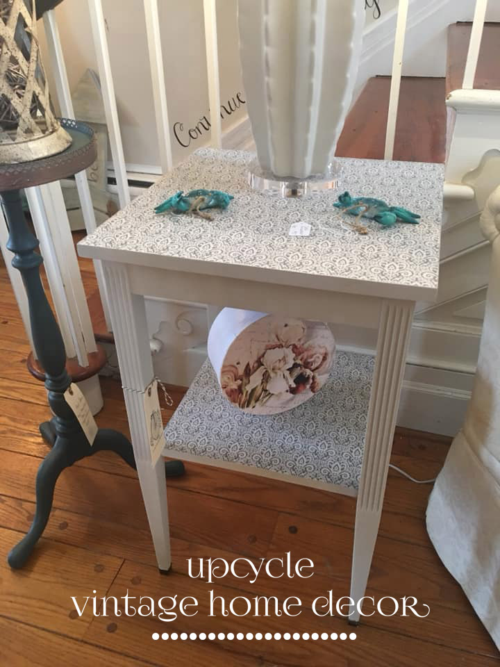 Painted table with decoupaged tissue on shelf and top.